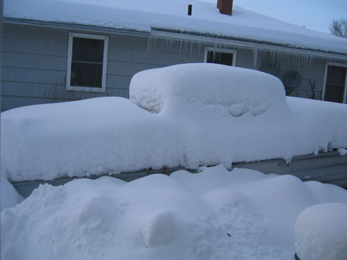 1960 Biscayne parts car under snow