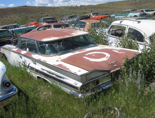 The 1960 Impala as it was found in a field.